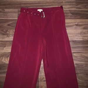High waisted deep red trousers with belt sewn on